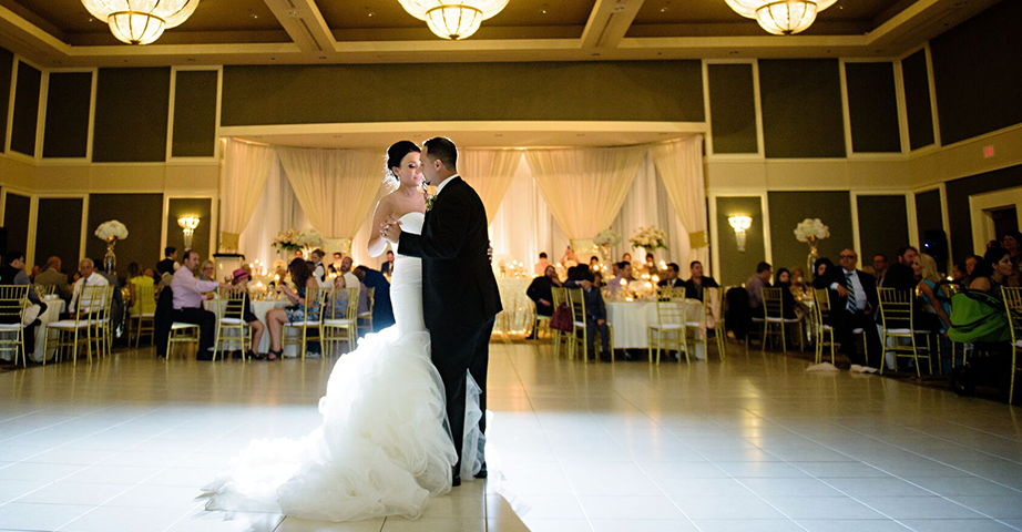 Wedding Couple Dancing in the Large Ballroom
