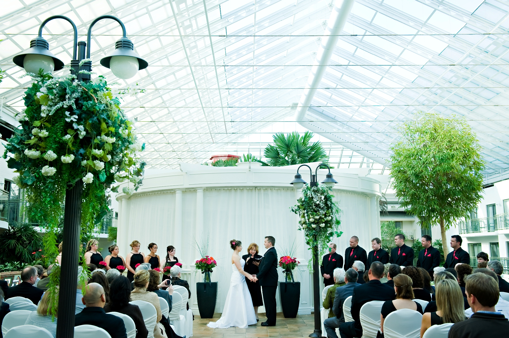 Wedding Taking Place Under Glass Ceiling Atrium At Lamplighter Inn