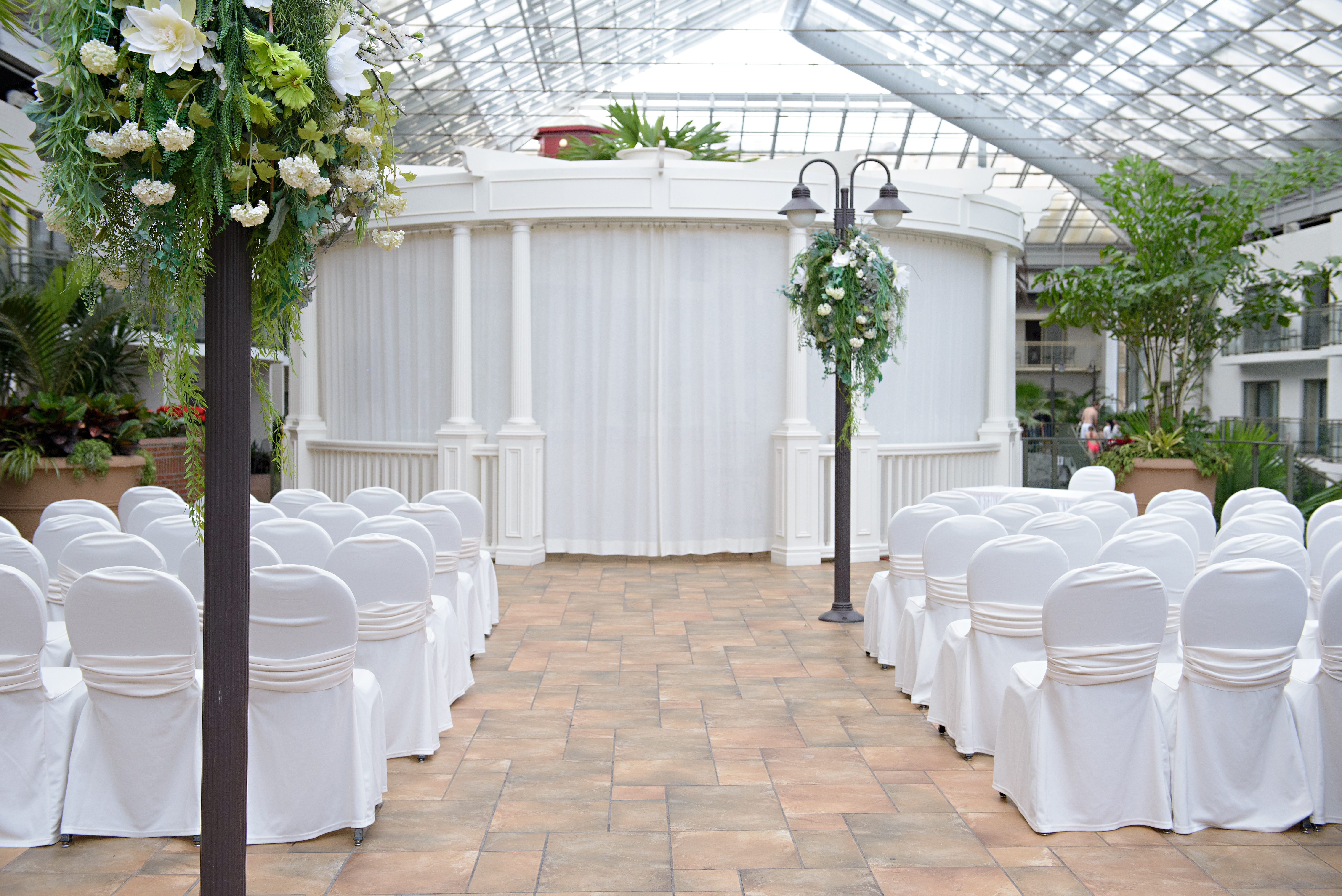 Wedding Taking Place Under Glass Ceiling Atrium