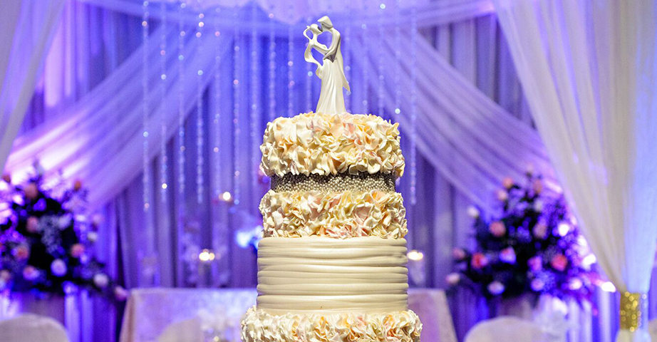 Wedding Cake With Modern Cake Topper And Floral Accents