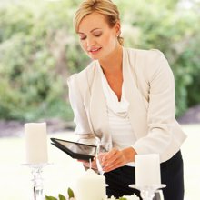 Female Wedding Planner Setting Up A Table